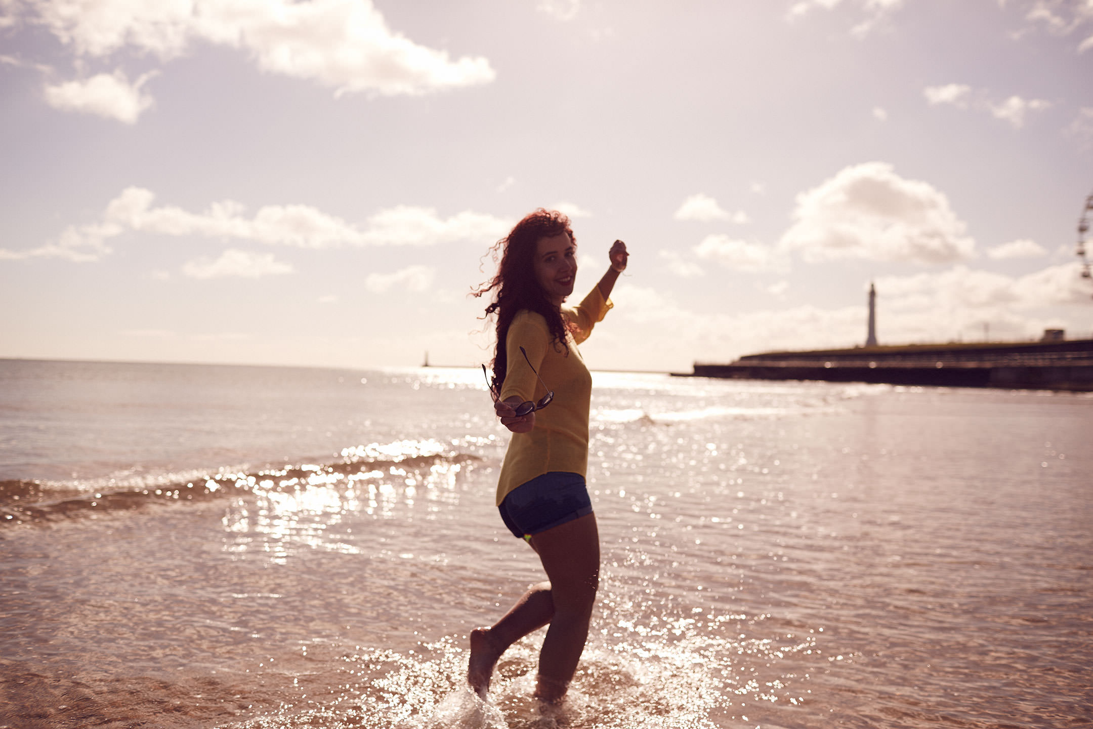 Woman wading in the sea at Roker beach