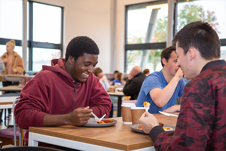 Eating on campus – students enjoying the food in The Riverside