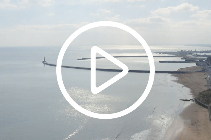 image of sunderland coast with play button icon