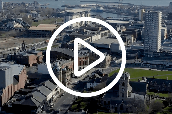 wide shot of sunderland city with play button icon