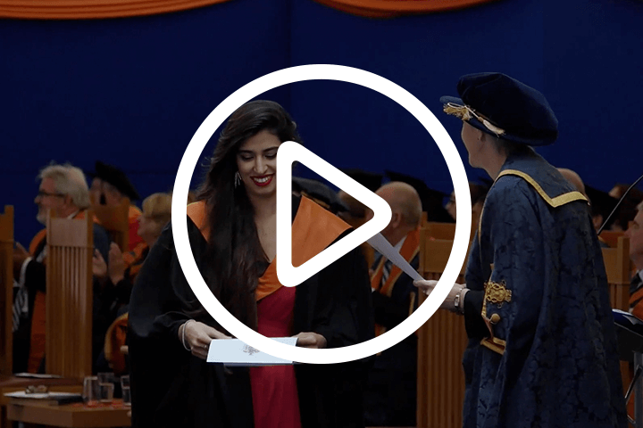Student graduating, with play icon