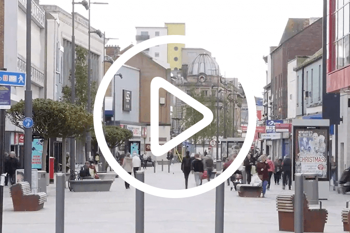 sunderland high street, with play button icon