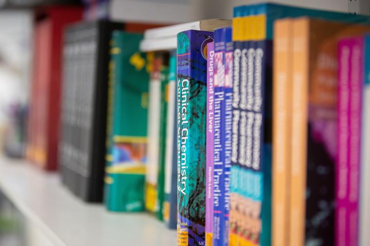 A row of pharmacy text books