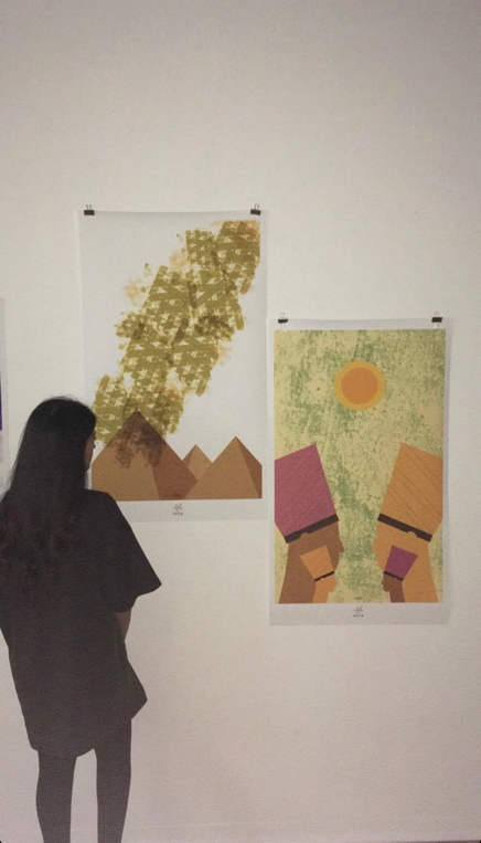 Afsina with her Graphic Design work