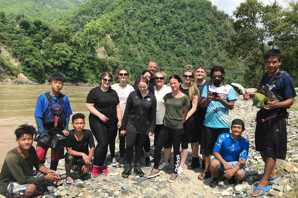 Sociology students with their white water rafting guides in Nepal