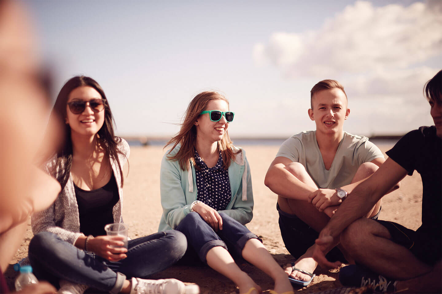 People sitting smiling on the beach