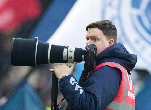 Luke Nickerson, Photography graduate, holding camera