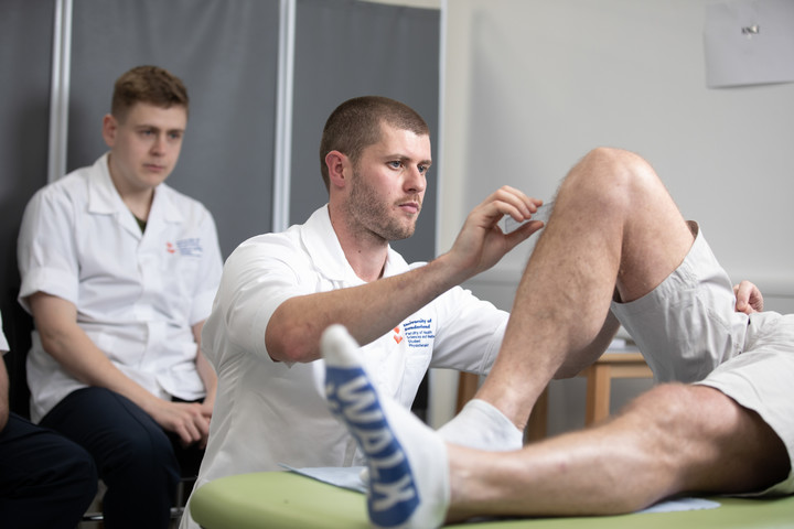 A student physiotherapist is practicing clinical skills on a patient