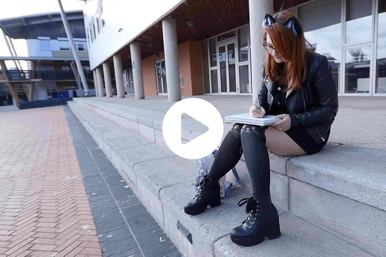A student sketching at the Sir Tom Cowie Campus at St Peter's