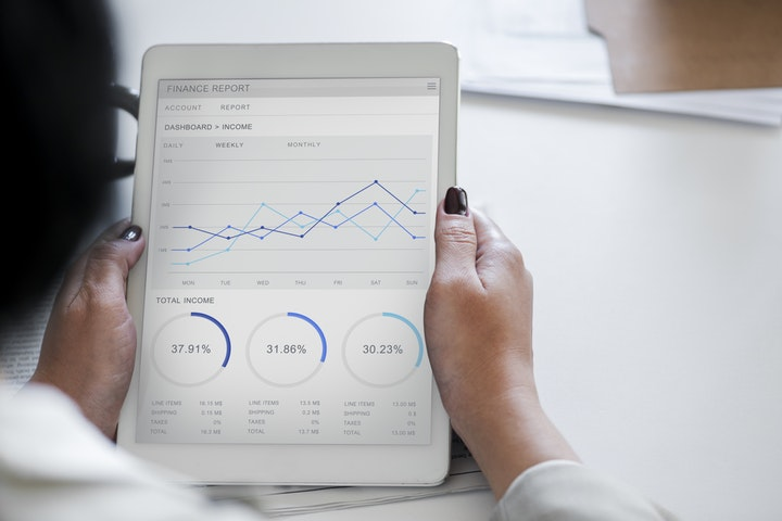 A man analysing data on an iPad