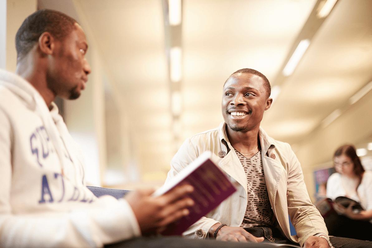 smiling postgraduate students