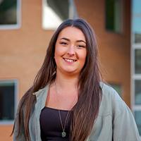 Graduate Emma Millen smiling to camera