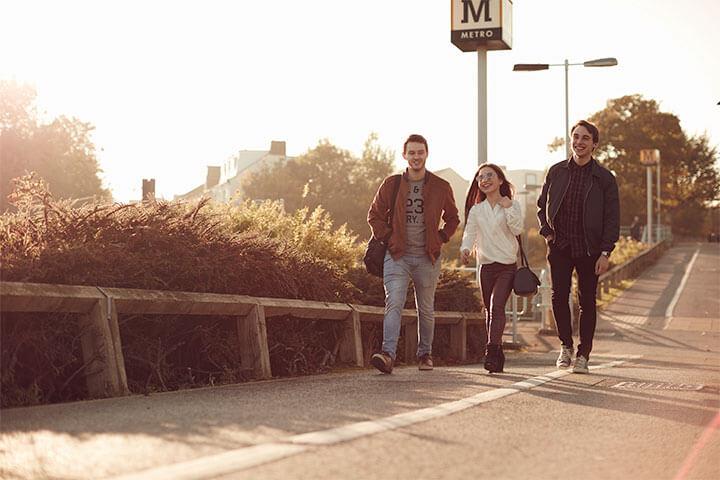 Students walking past University metro station