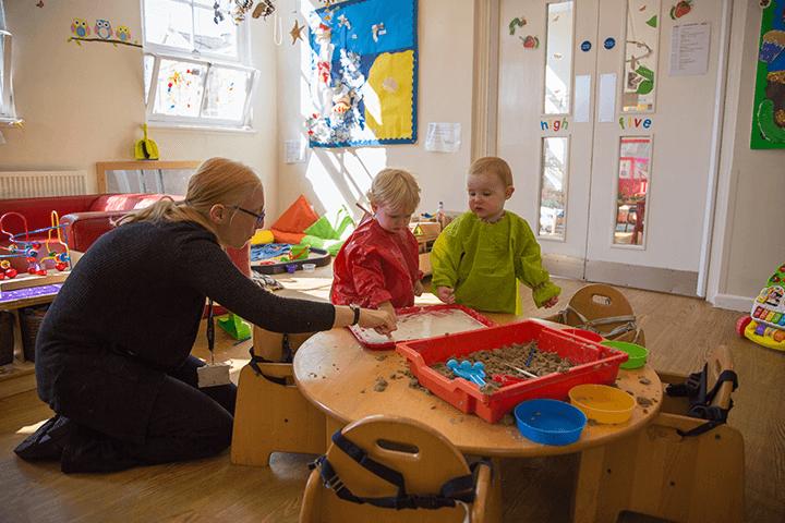 nursery staff member and children