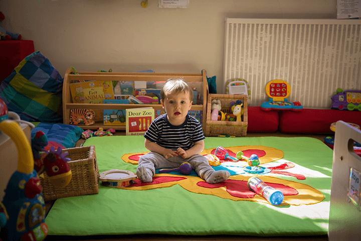 nursery child on floor