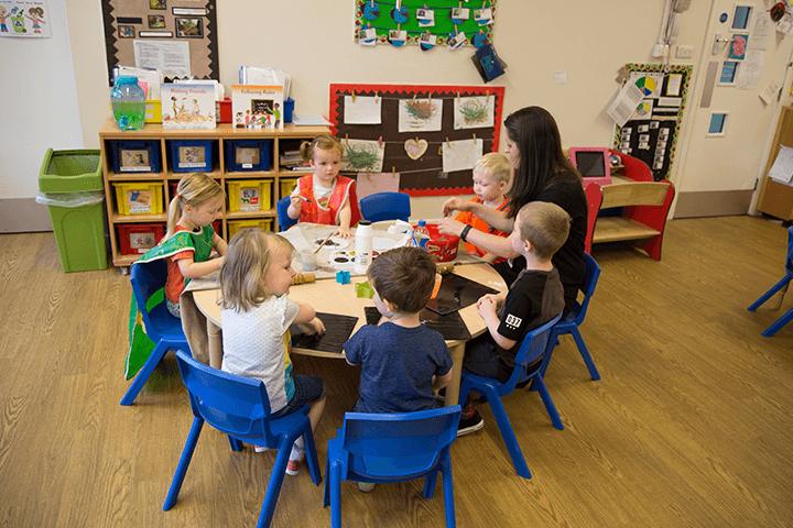 nursery children around table