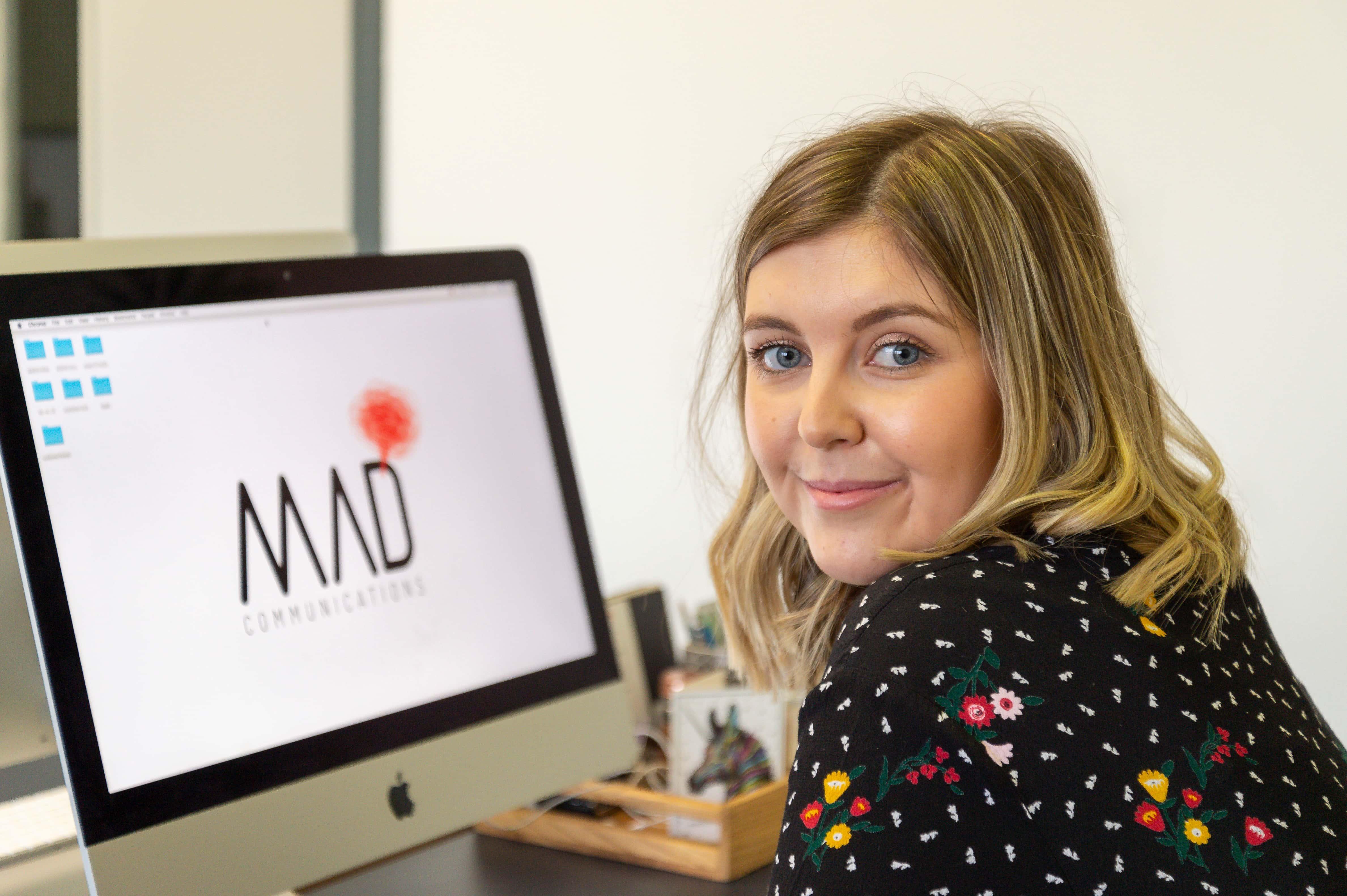 M.A.D staff sat at computer