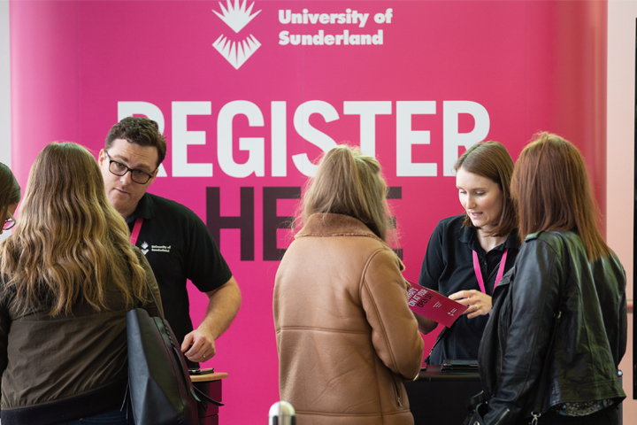 Crowd of people registering at open day