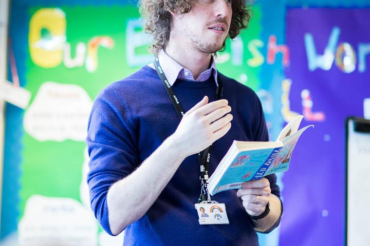 Primary Teacher addressing class.