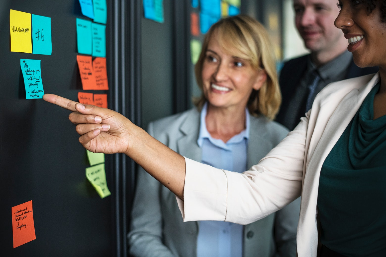 People around a board analysing comments left on sticky notes
