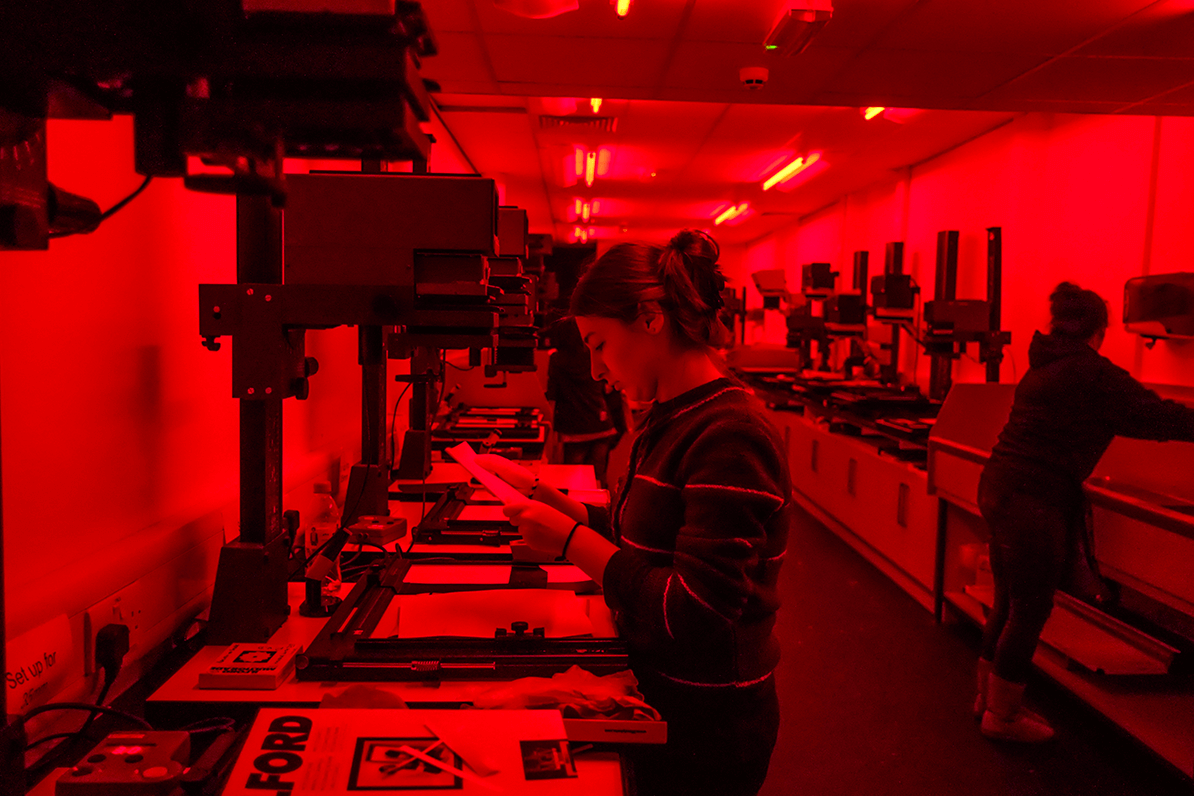 Student working in the dark room