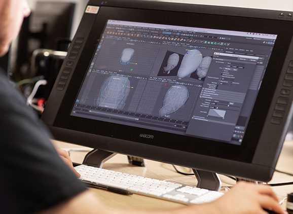 Student using Maya software on computer