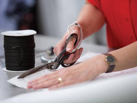 Student cutting fabric