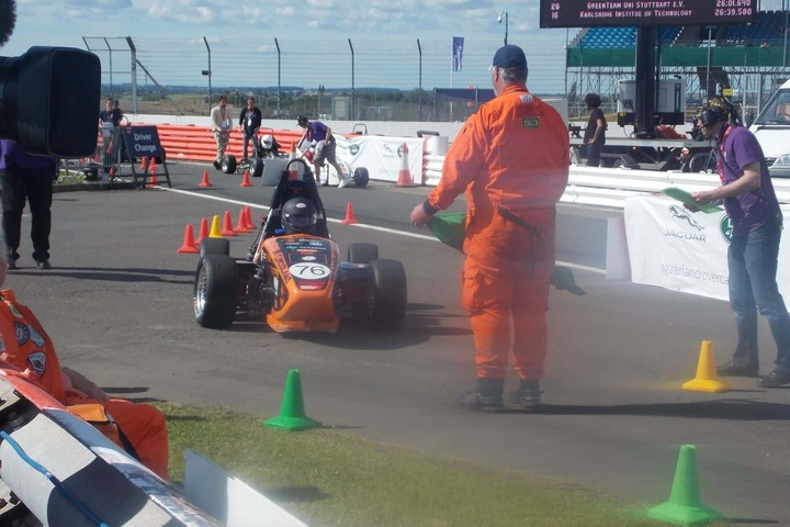 A student is driving the Formula Student car on a race track