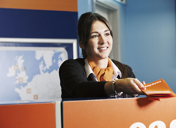 Air stewardess on check in desk