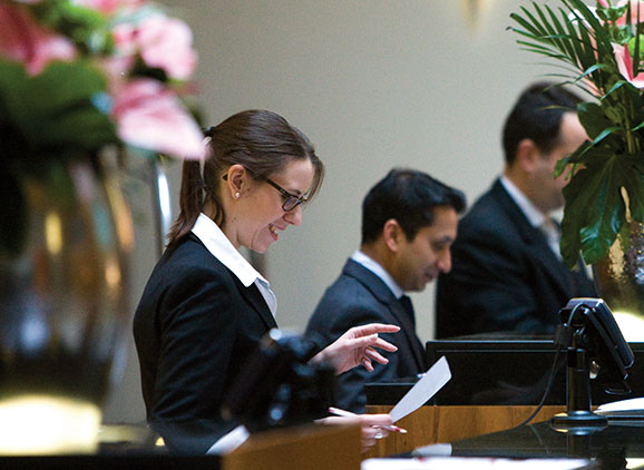 Staff on hotel reception desk