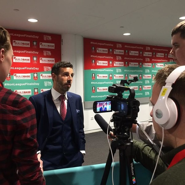 Journalism students interviewing Julio Arca in the press box at Wembley Stadium