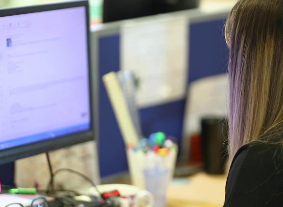 A female student using a desktop computer