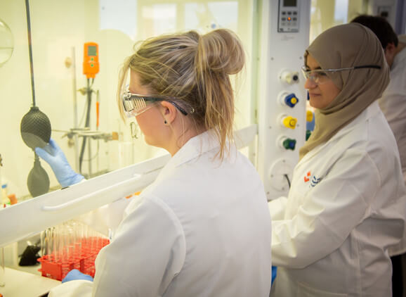 A student and lecturer carrying out an experiment in the lab