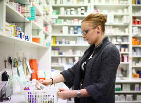 Student looking at medication in the pharmacy dispensary