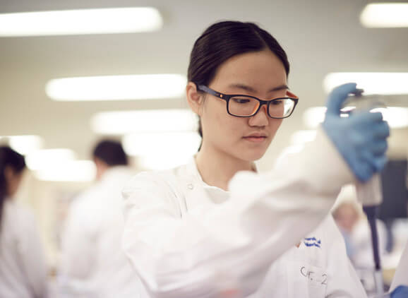 A student carrying out an experiment in the lab