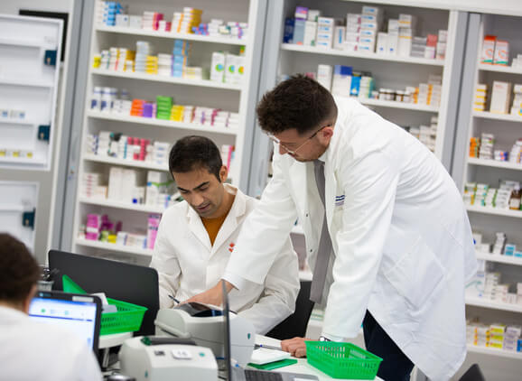 Two pharmacy students working in the pharmacy dispensary