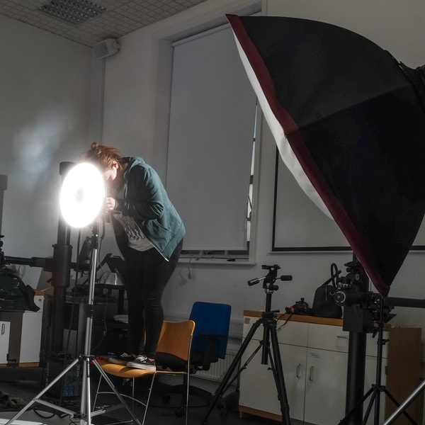 A Photography student in the studio