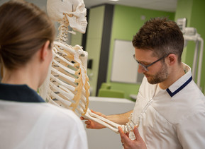 An academic working with a skeleton
