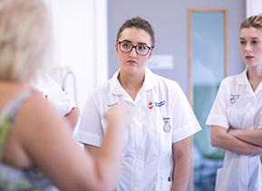 Nurses talking to patient