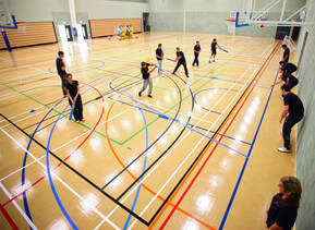Students practicing in the sports hall
