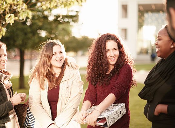 Group of female students smiling.
