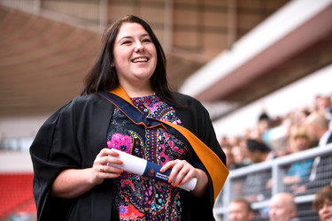 woman graduate with pink top